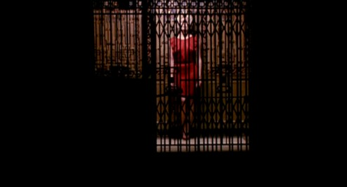 The-Grifters_Angelica-Huston-red-dress-elevator-full_cap-494x267